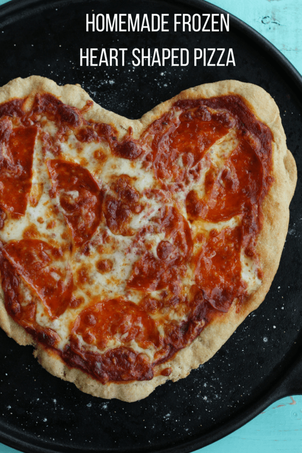 Homemade Frozen Heart-Shaped Pizzas are the perfect Valentines dinner for your family. Make the pizzas and freeze them up to two months before the big day for a quick and homemade dinner.