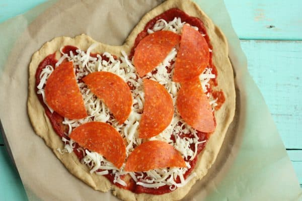 heart-shaped pizza with pepperoni on top