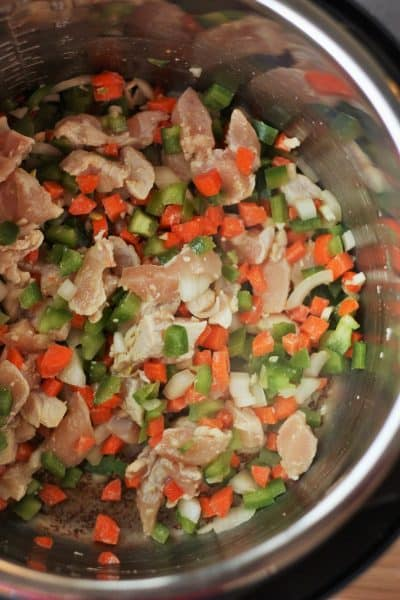 chicken, green pepper, carrots, and onions in an Instant Pot   Sustainablecooks.com