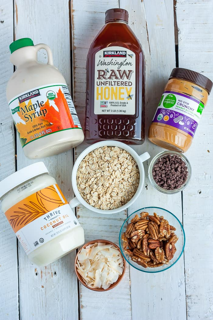 A bowl of oats, honey, peanut butter and other ingredients for making granola bars