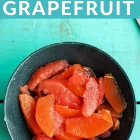 A blue bowl of segemented oranges and grapefruit