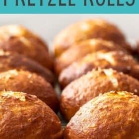 a cooling rack of homemade pretzel rolls