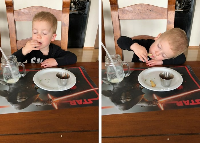 toddler boy sleeping and eating homemade french fries