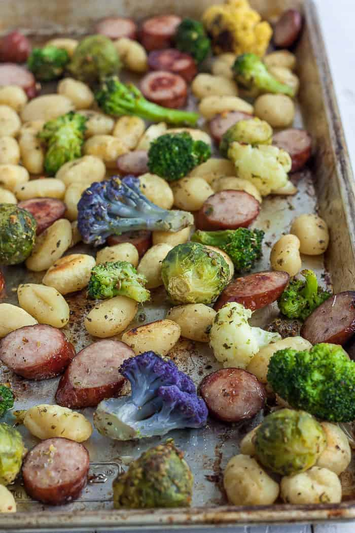 A sheet pan with gnocchi, sliced chicken sausage, and veggies