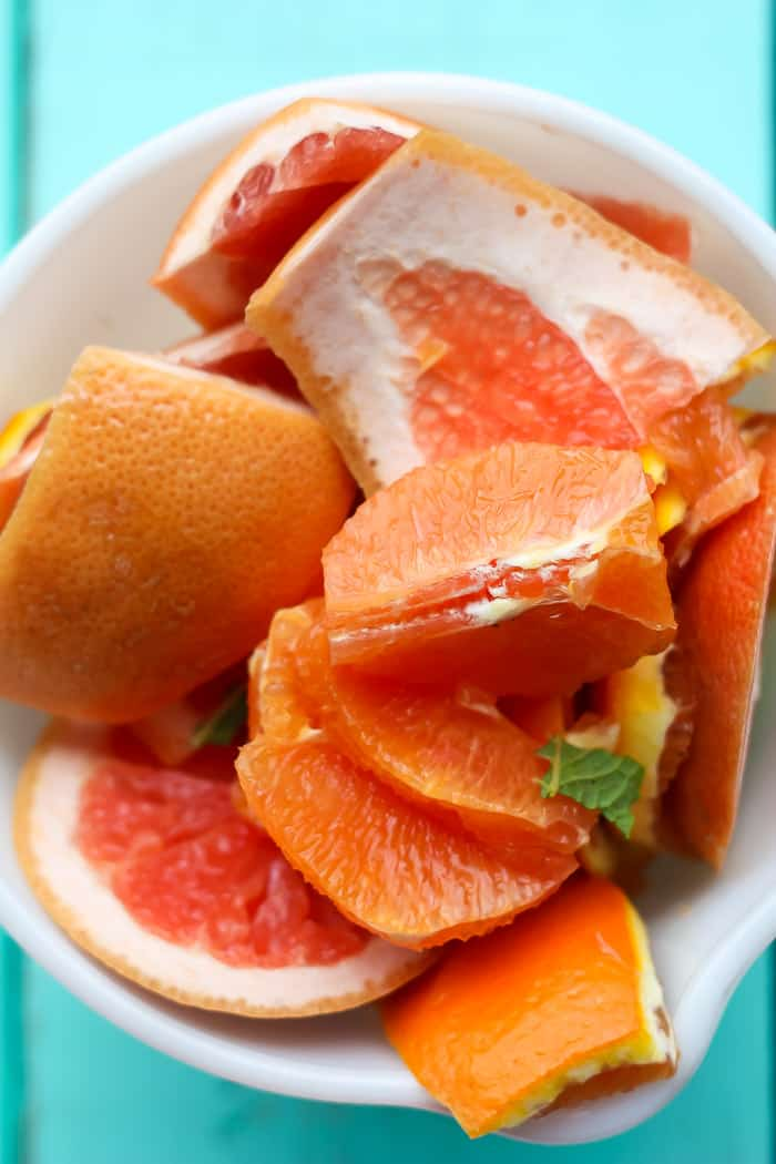 a bowl with orange and grapefruit peels leftover from segementing citrus