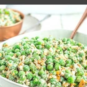 a white bowl with healthy green pea salad and a bronze spoon