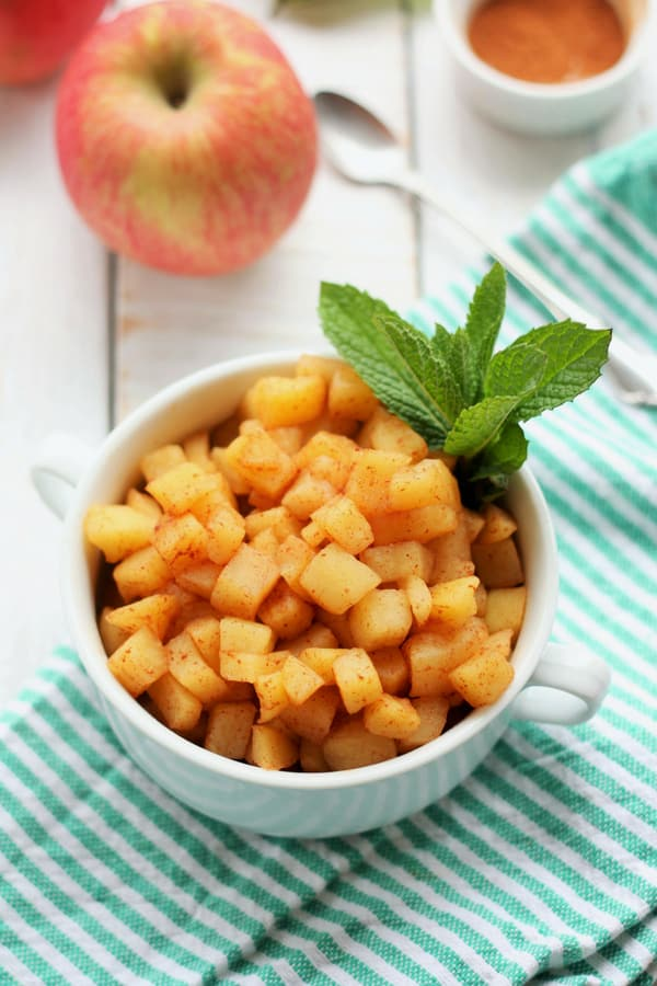 Simple and sweet, Warm Stovetop Cinnamon Apples are the perfect healthy comfort food. A bowl of cozy cinnamon apples are sugar-free, dairy-free, gluten-free, vegan, paleo, and Whole30 compliant. #sustainablecooks #apples #cinnamonapples #paleo #whole30