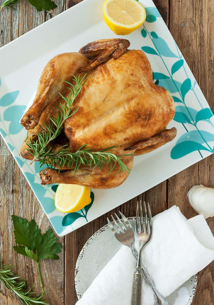 whole30 roast chicken on a blue and white square plate