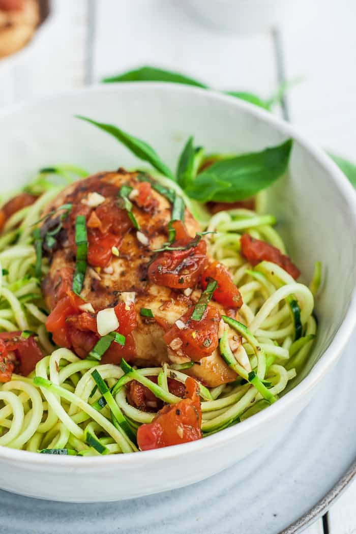 Instant Pot bruschetta Chicken in a bowl of zoodles