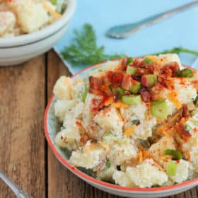 A bowl of baked potato salad