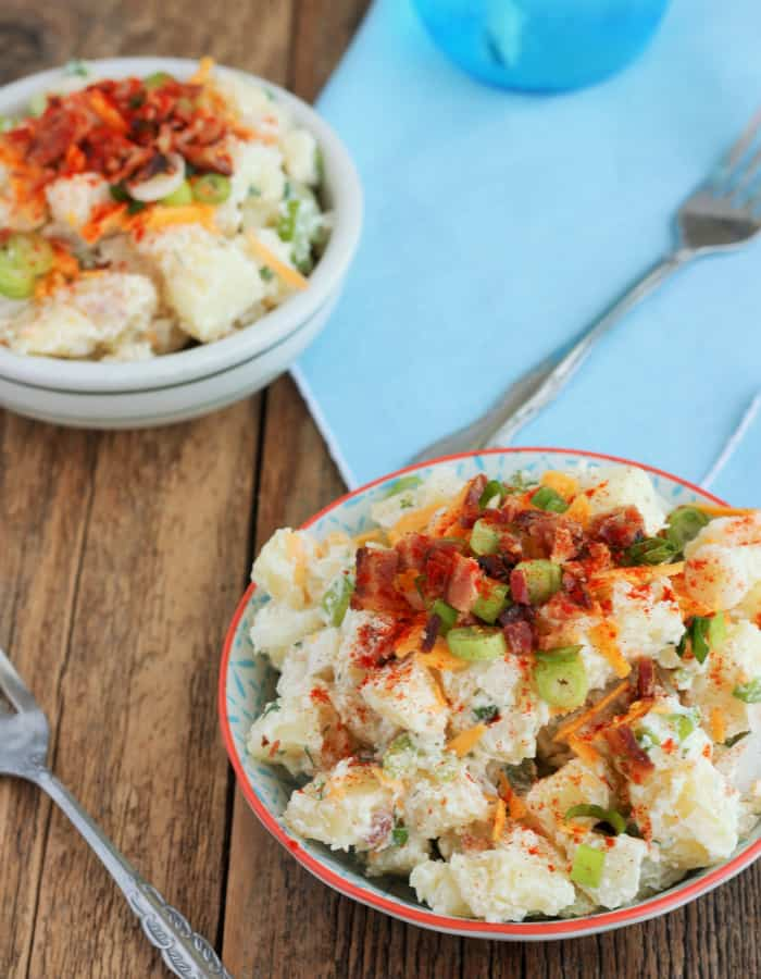 Two bowls of baked potato salad