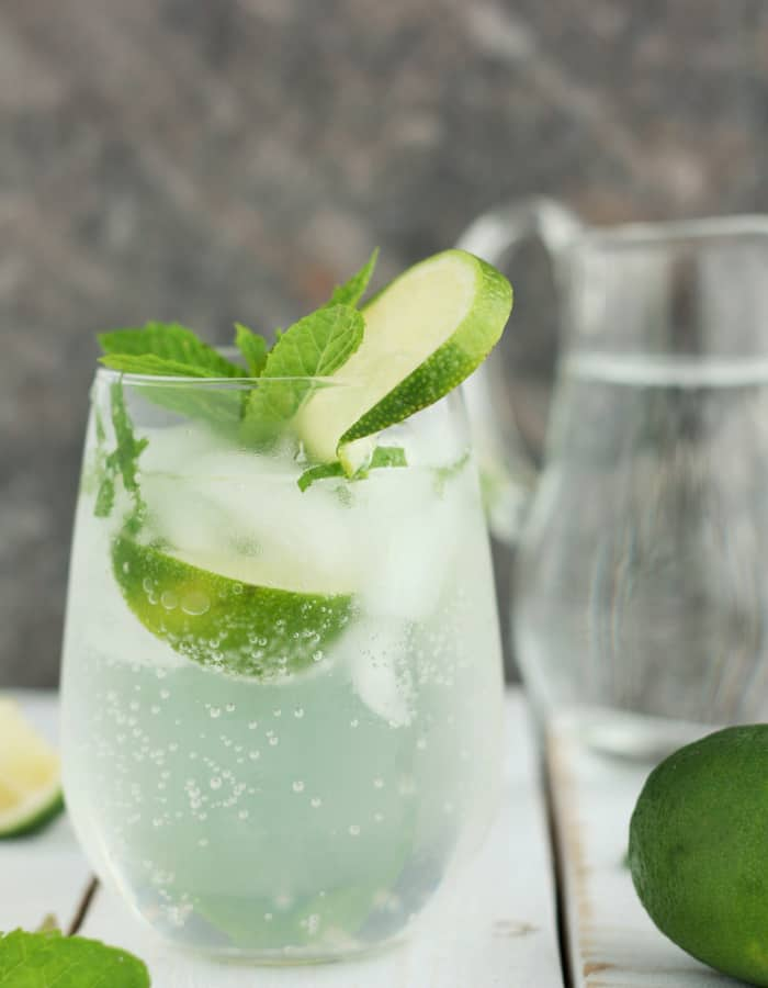 Glass filled with a virgin mojito with lime and mint