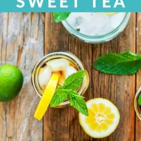 a mason jar of healthy sweet tea topped with lemons and mint