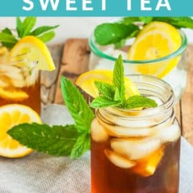 mason jars filled with honey sweet tea and topped with mint and lemons