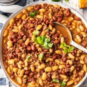 a bowl of instant pot cowboy beans topped with cilantro