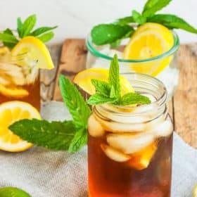 a mason jar of healthy sweet tea topped with lemons and mint