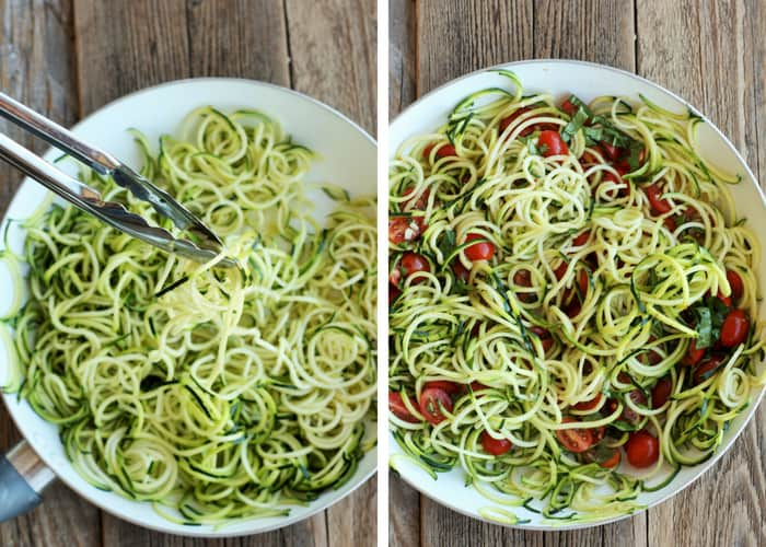 zoodles and tomatoes in a frying pan