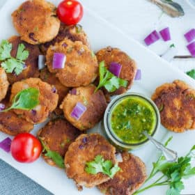 a platter of paleo salmon cakes with cilantro and chimichurri