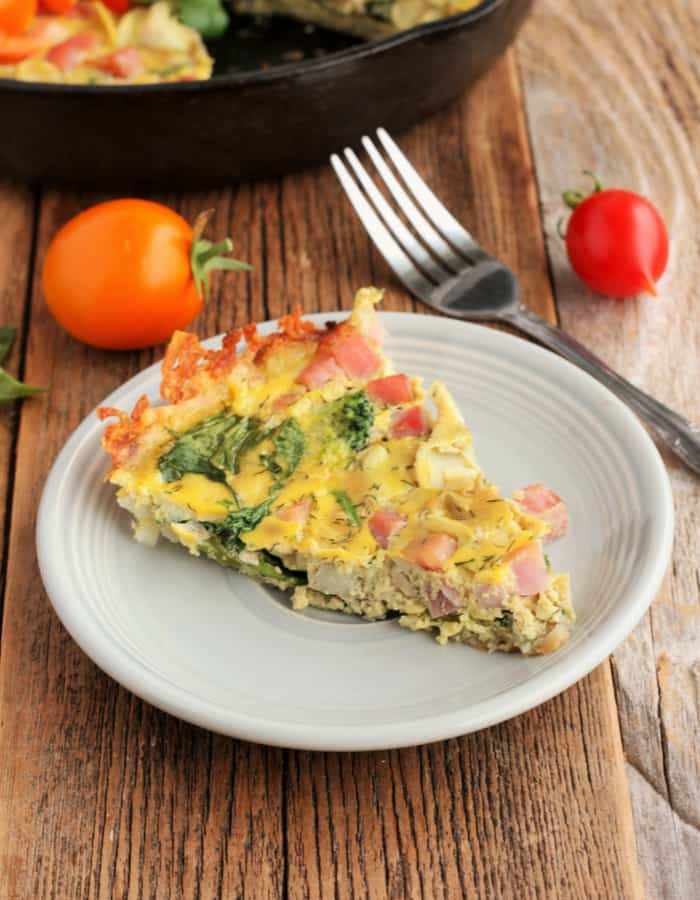 a slice of whole30 quiche on a plate with a fork
