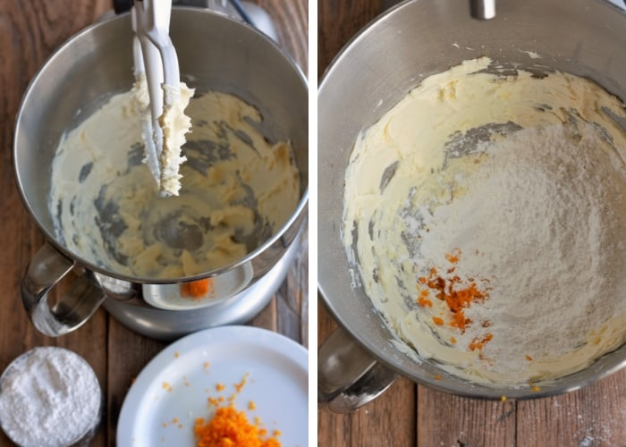 ingredients for orange cream cheese frosting in a stand mixer