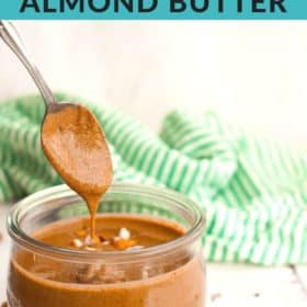 homemade cinnamon almond butter on a spoon with a jar