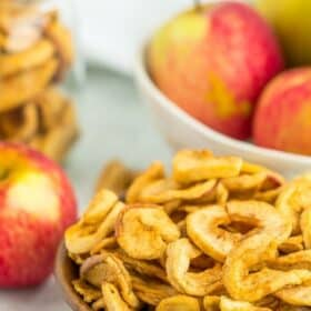 a wooden bowl of dried apples