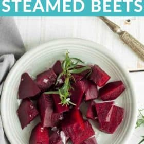 A plate of steamed beets topped with tarragon and flaky sea salt