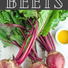A bunch of beets with olive oil on a white board