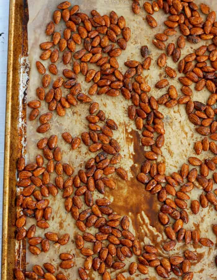 almonds on a baking sheet for making cinnamon almond butter