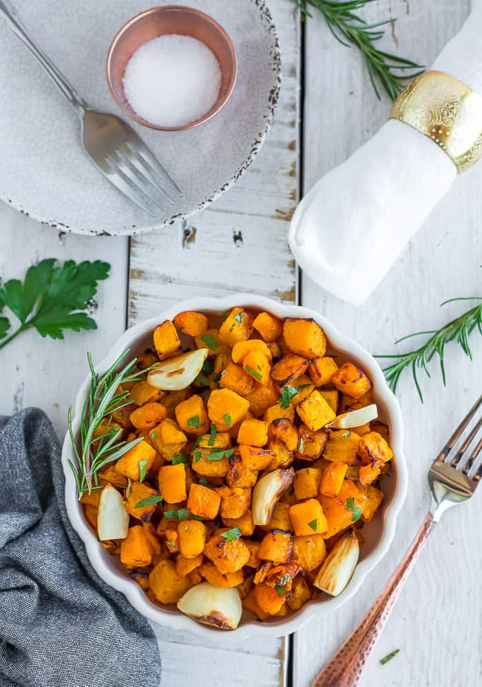 Cubes of butternut squash in a white bowl