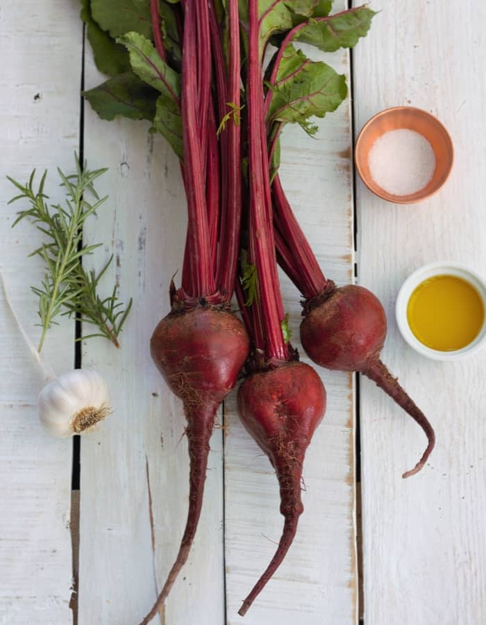 beets, salt, and herbs on a white board