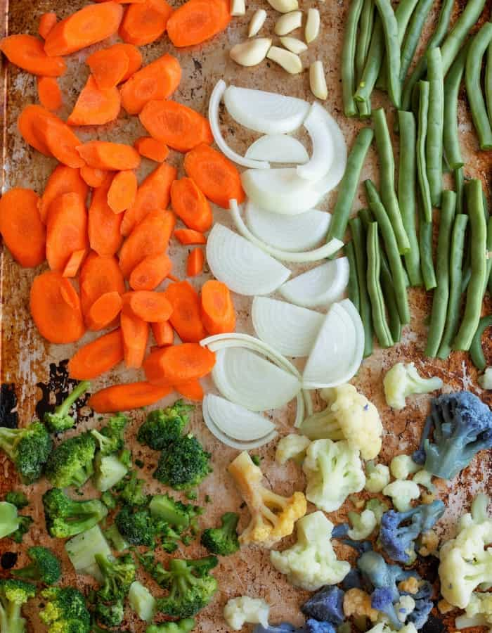 sliced veggies on a sheet pan for roasting frozen vegetables