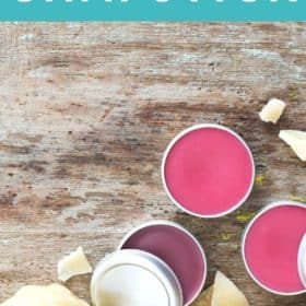 containers of homemade lip balm with beeswax on a wooden board