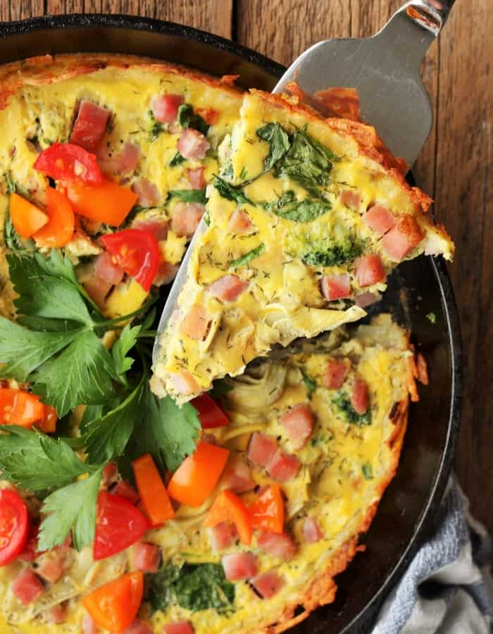 healthy quiche with hash brown crust with tomatoes for make ahead christmas morning breakfasts