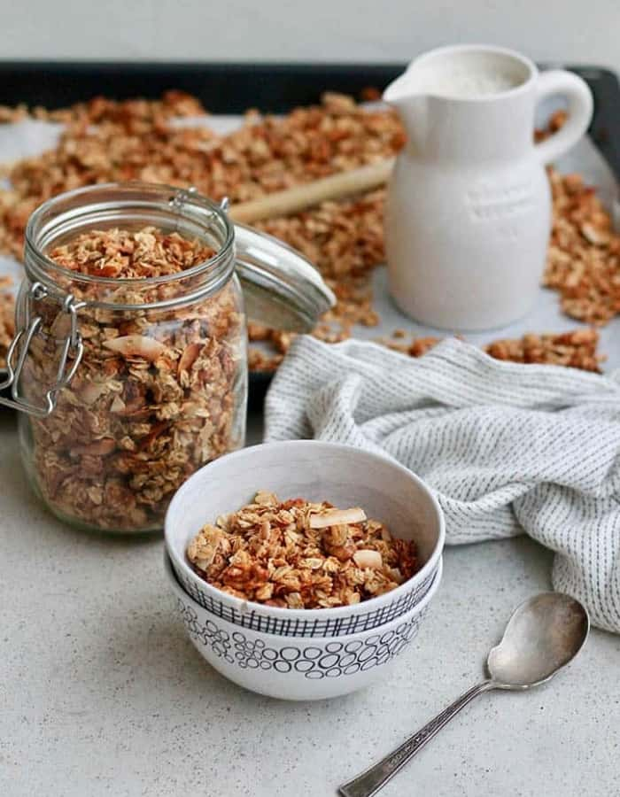 a bowl and jar of coconut banana granola for make ahead christmas morning breakfasts
