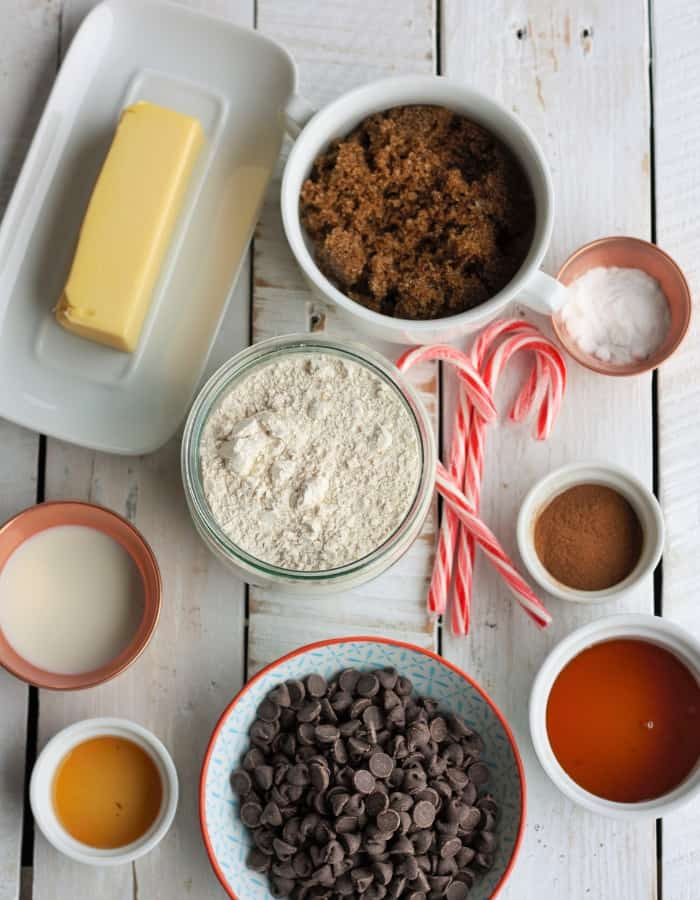 butter, chocolate, candy canes and other ingredients for peppermint bark graham crackers