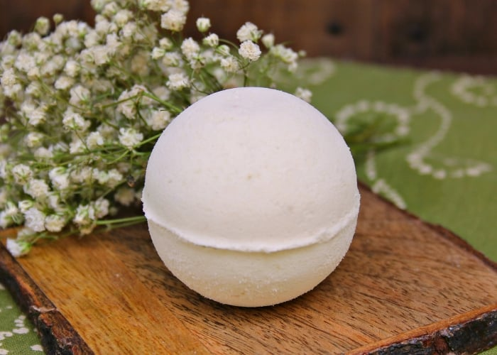 a avocado bath bomb with baby's breath