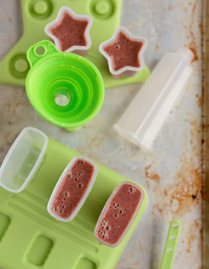 Popsicle molds on a tray while making healthy tea popsicles for sore throats