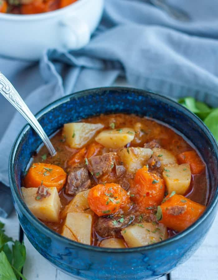 whole30 beef stew in a blue bowl for whole30 dinners