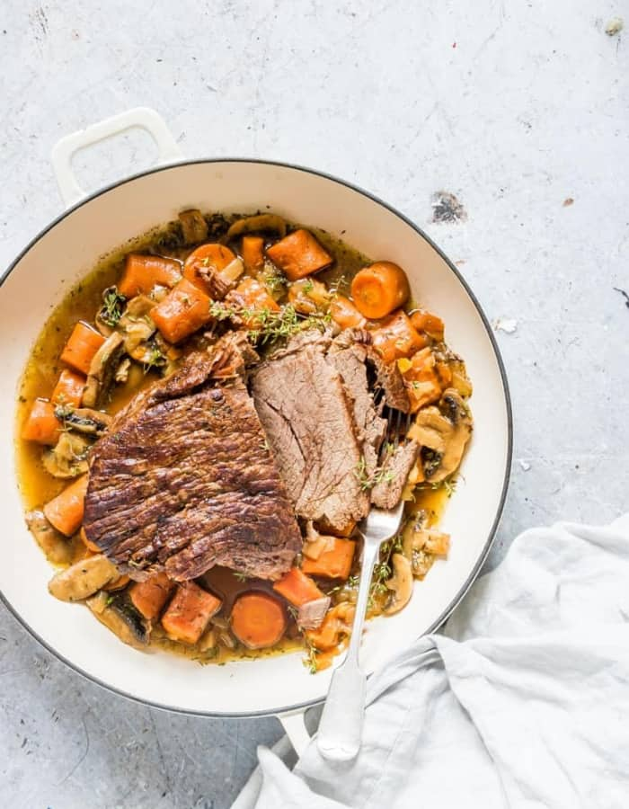 instant pot pot roast in a white pan for whole30 dinners