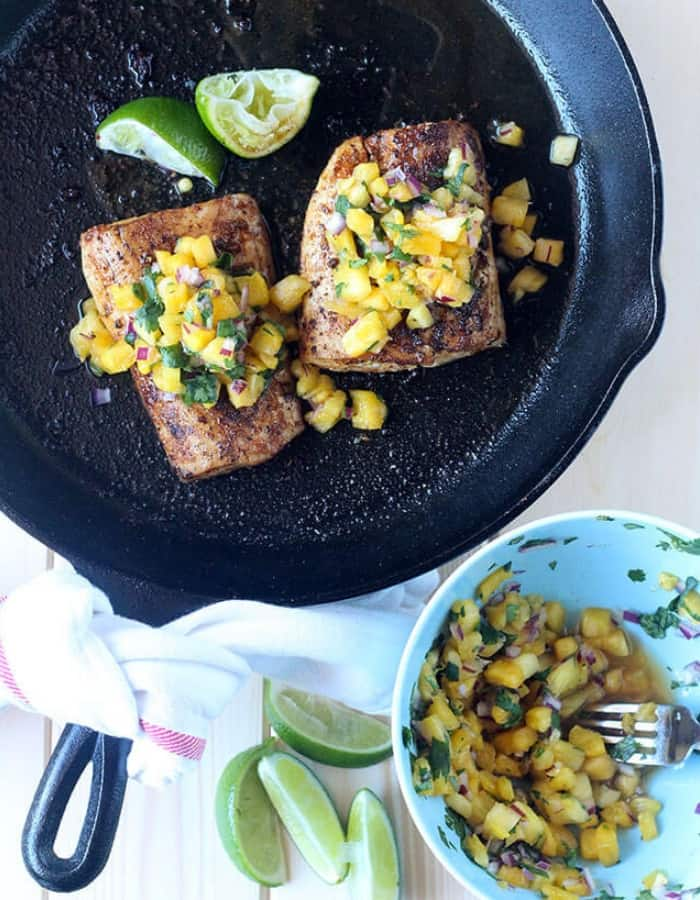 mahi mahi in a cast iron skillet with pineapple salsa for whole30 dinners