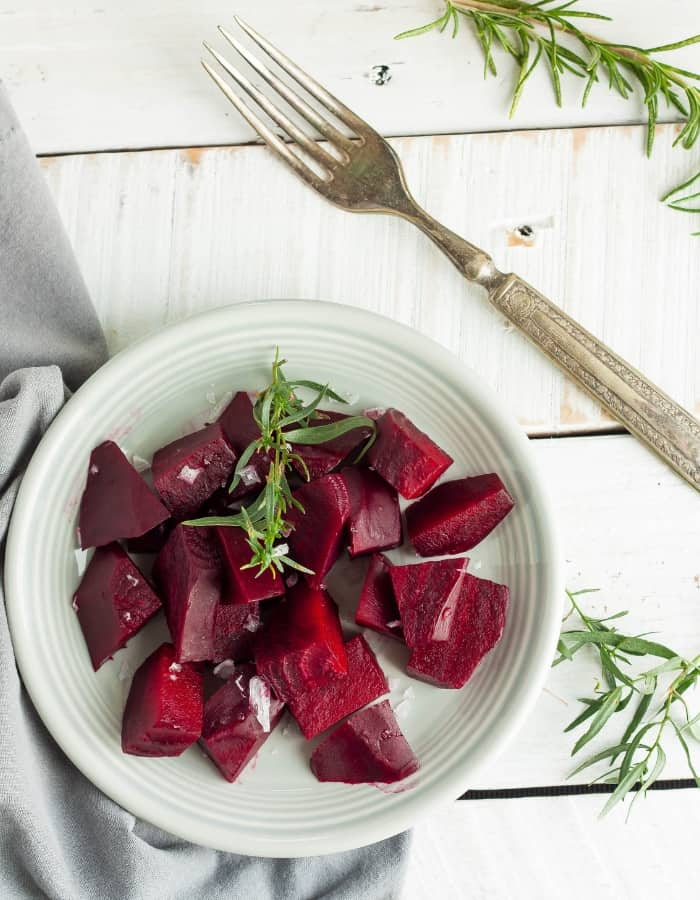 pressure cooker beets with thyme and salt on a plate