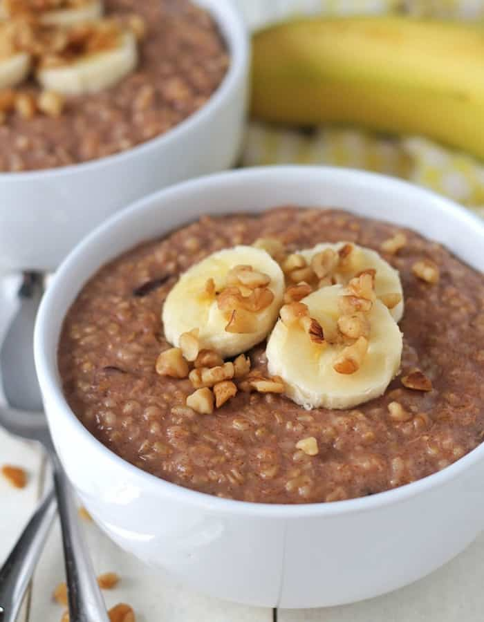 instant pot banana oatmeal in a bowl topped with bananas