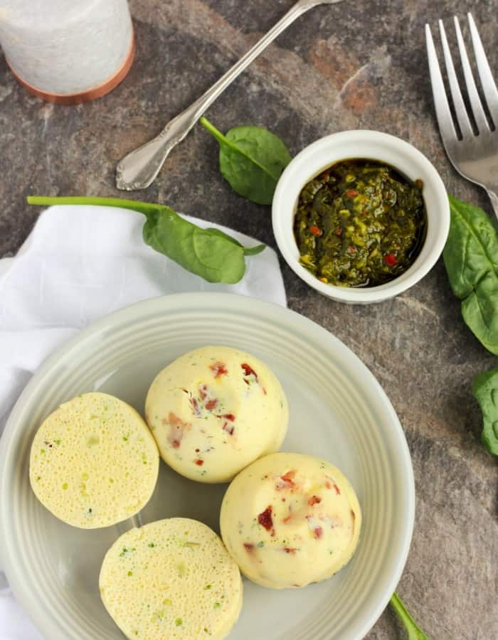 Instant Pot egg bites on a plate with chimichurri