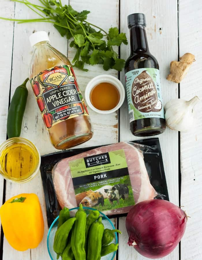 butcher box pork, cilantor, coconut aminos and other ingredients for pork fajitas
