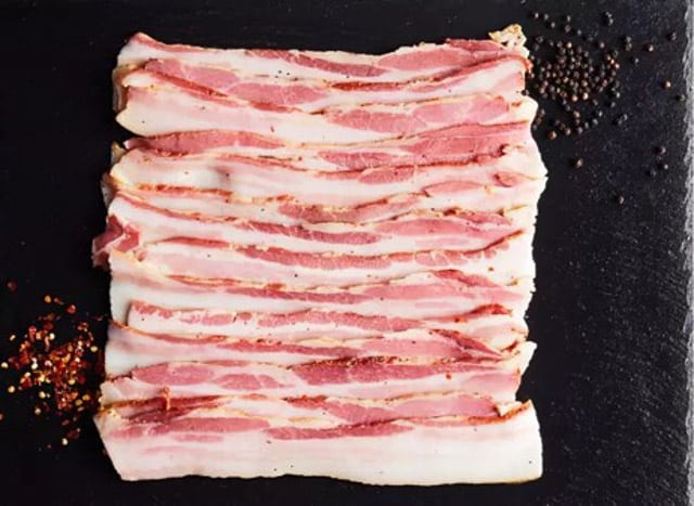 Thrive sugar-free whole30 bacon on a black surface