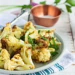 A plate of paleo air fryer cauliflower with parsley