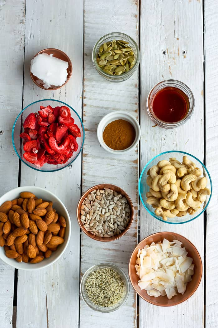 Nuts, seeds, strawberries, and other ingredients for making paleo muesli