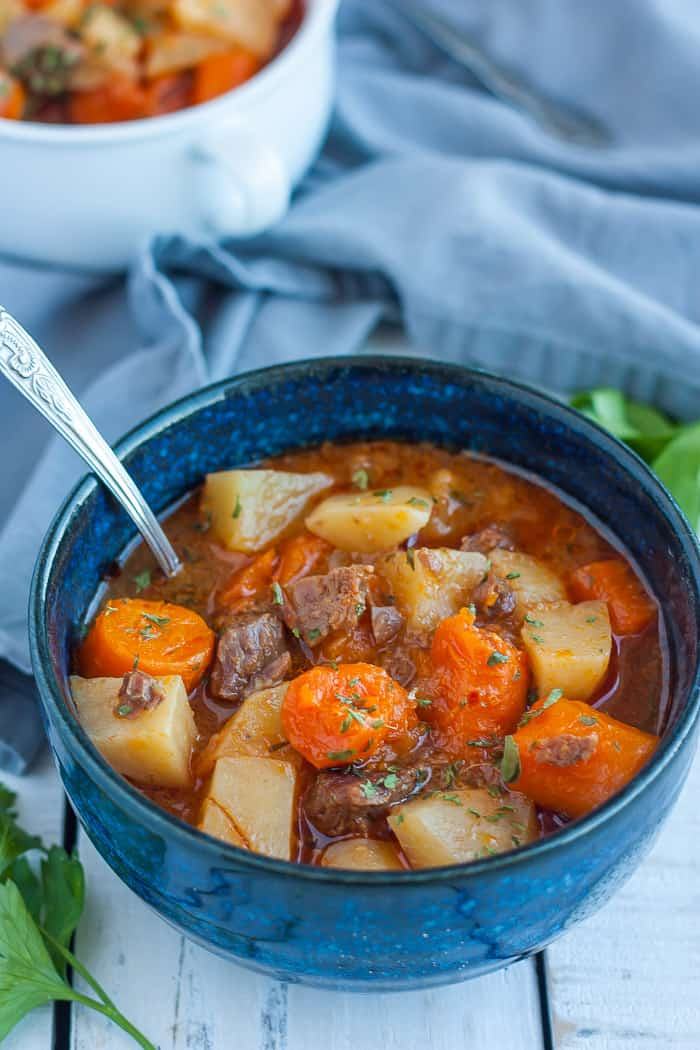 a blue bowl with whole30 beef stew