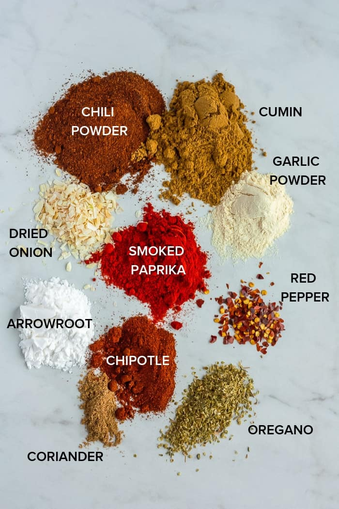 spices on a board for making whole30 taco seasoning